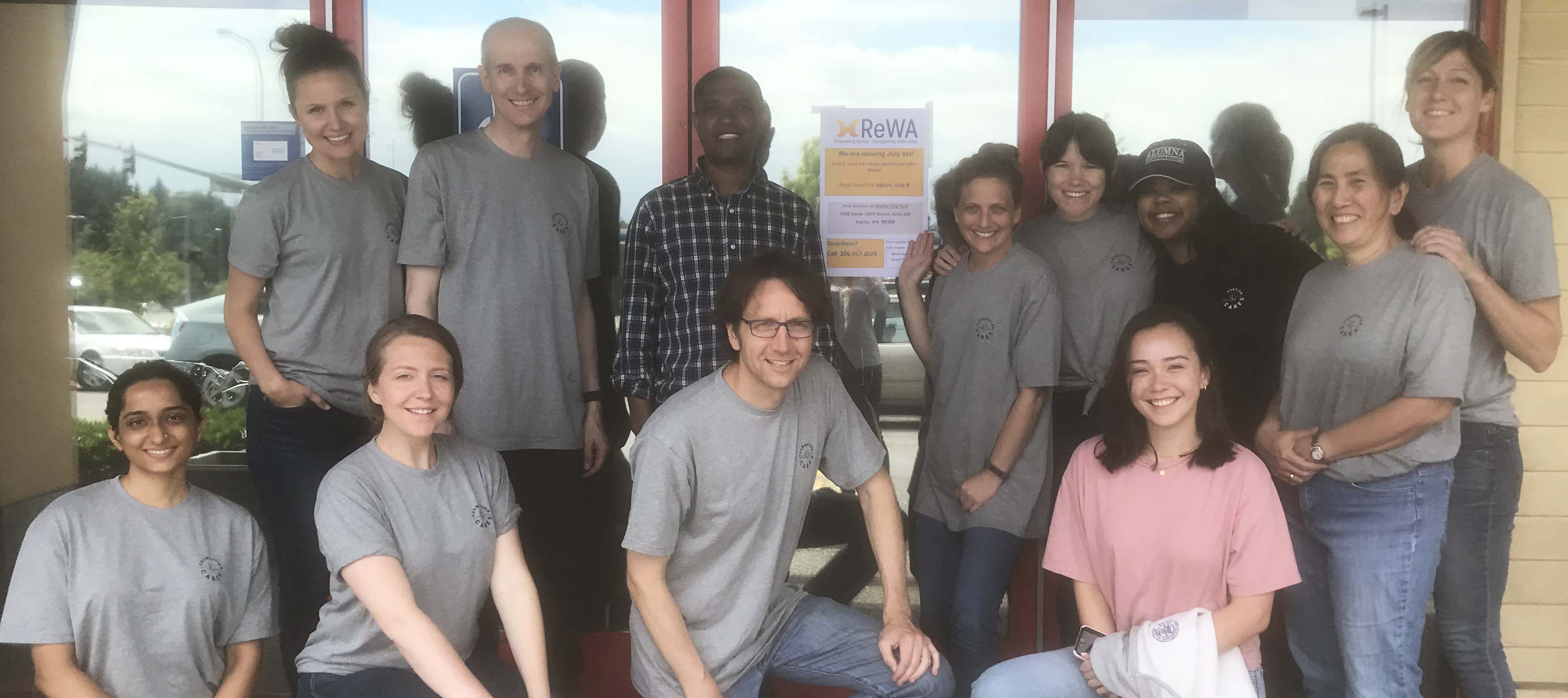 Gates Foundation Day of Caring volunteers pose for a group photo at ReWA's SeaTac office.
