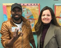 ReWA lawyer and client who received his Green Card after 4 years of delays