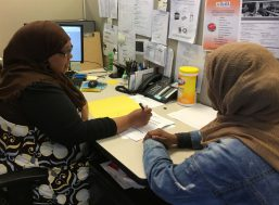 ReWA client consults with their case manager