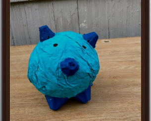 blue paper mache piggy bank created by Angel, a 3rd grader