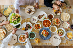photograph of family breaking the fast with dinner